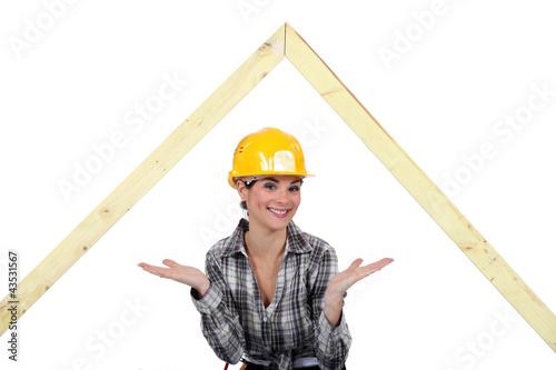 Female carpenter presenting wooden frame