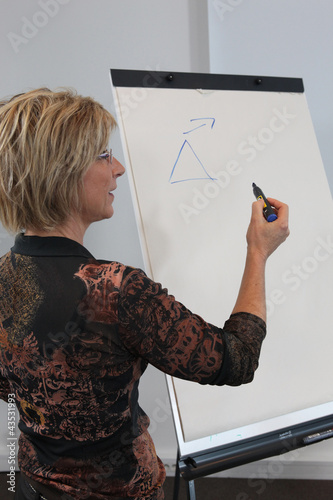 Woman writing on a board