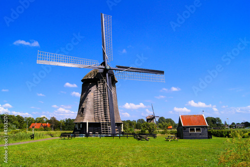 Traditional Dutch windmill under blue skies near Almaar