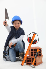 Little boy dressed as builder