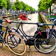 Bicycle along a canal in Amsterdam, the Netherlands