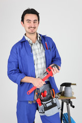 Man stood with wrench and blow torch