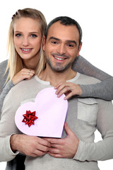 Couple with a heart shaped gift