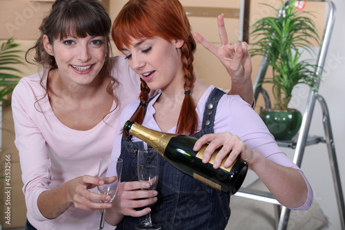 Girls celebrating a move with champagne