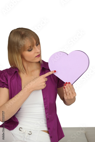 Woman pointing to a heart-shaped box
