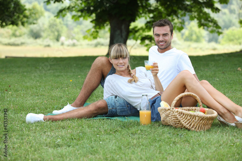 Couple picnicking in the countryside