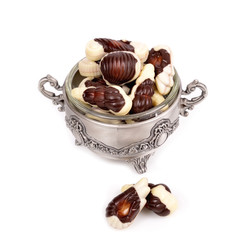 .Assorted chocolate candies , in a metal container