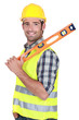 Happy worker resting spirit-level on shoulder