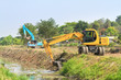 excavator along river