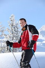 Smiling male skier