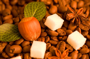 Coffee beans, nut and sugar background