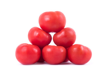 Ripe red tomatoes isolated on a white background