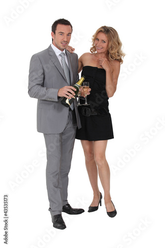 Couple with champagne bottle