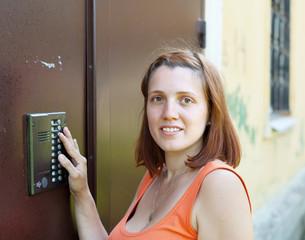 woman uses intercom
