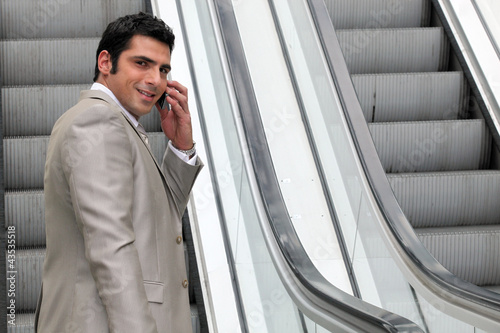 Executive on escalator