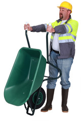Tradesman emptying a wheelbarrow