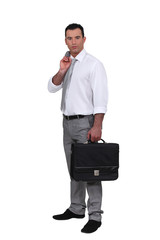 Man holding jacket over shoulder and holding briefcase