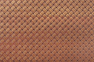 Brown leather background with interlaced design