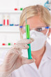 Young attractive laboratory assistant researching injection