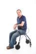 Satisfied man resting on a health walker