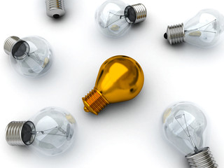 Idea concept golden lying bulb out from others bulbs