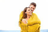 Couple Wrapped in Blanket Looking Happy