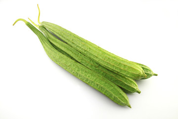 Luffa acutangula on white background