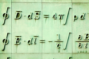 Mathematic language sculpture in Warsaw library wall. Poland