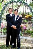 Gay Couple Under Wedding Arch