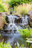 Fototapety Flowing waterfall in the park