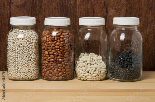 Beans in glass canisters in a kitchen