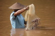Pêcheur en Asie