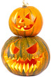 Halloween pumpkins with scary face over white background