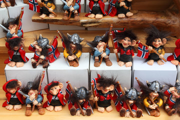 Many rows of amusing toy vikings with flags