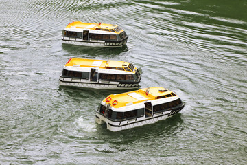 Three empty passengers transport vessels with yellow roofs
