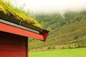Corner of wooden roof of Norwegian house on hill,