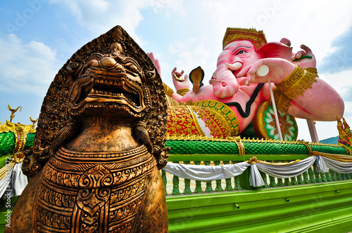 elephant headed god and bronze lion statue in Thailand