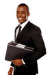 Handsome young executive holding files