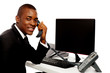 African businessman attending phone call