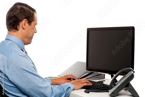 Side view male accountant working in office