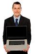 Smart businessman displaying laptop to you