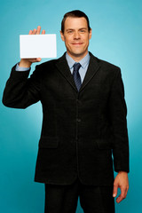 Isolated corporate man holding blank placard