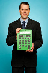 Corporate guy showing big green calculator