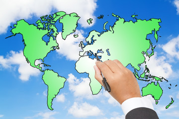 Businessman Draw a world map  on blue sky