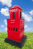 postbox on road side with blue sky poster