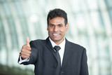 Portrait of an Indian Business man with thumbs up.