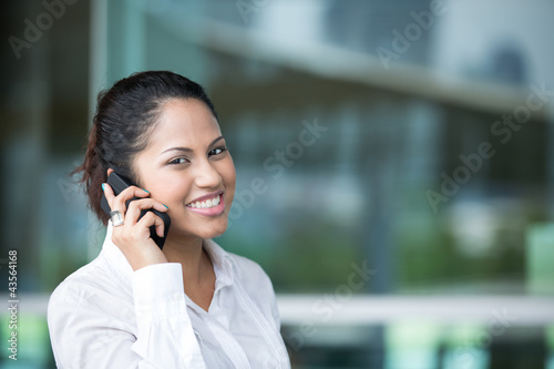 Indian business woman using mobile phone.