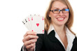 young beautiful girl holding four aces