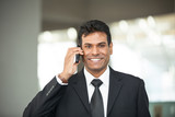 Indian business man using mobile phone.