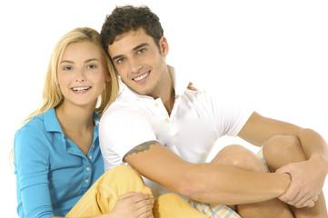 Happy young couple .sitting floor Isolated